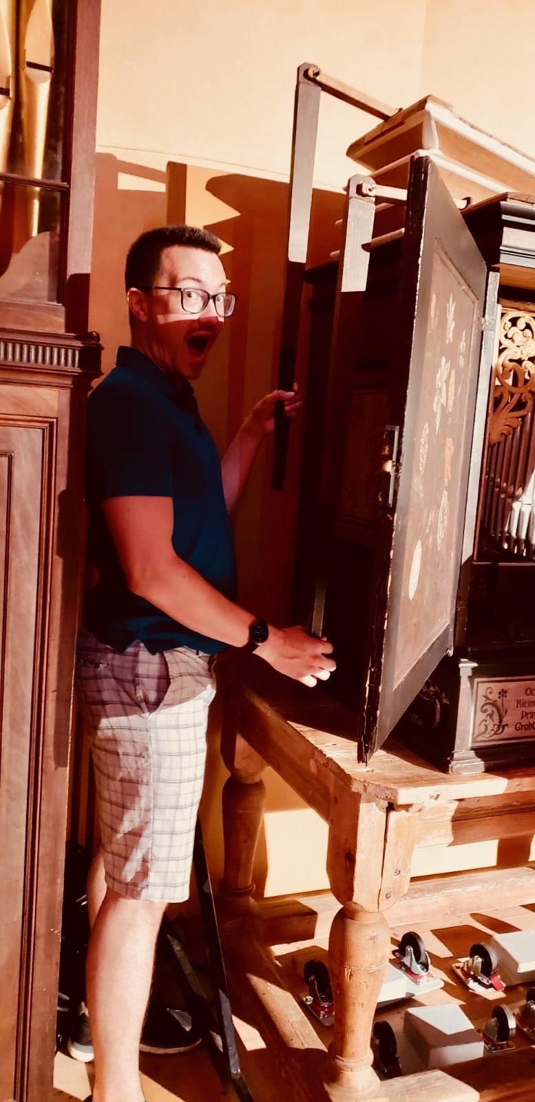 Corey De Tar pumps the bellows of the 17th-c organ in Göteborg University.