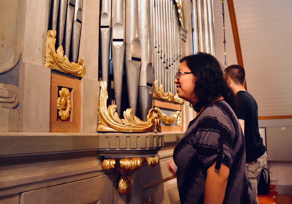 Jennifer Hsiao examines the original pipework of the 1783 Schiörlin organ in Jonsered, Sweden.