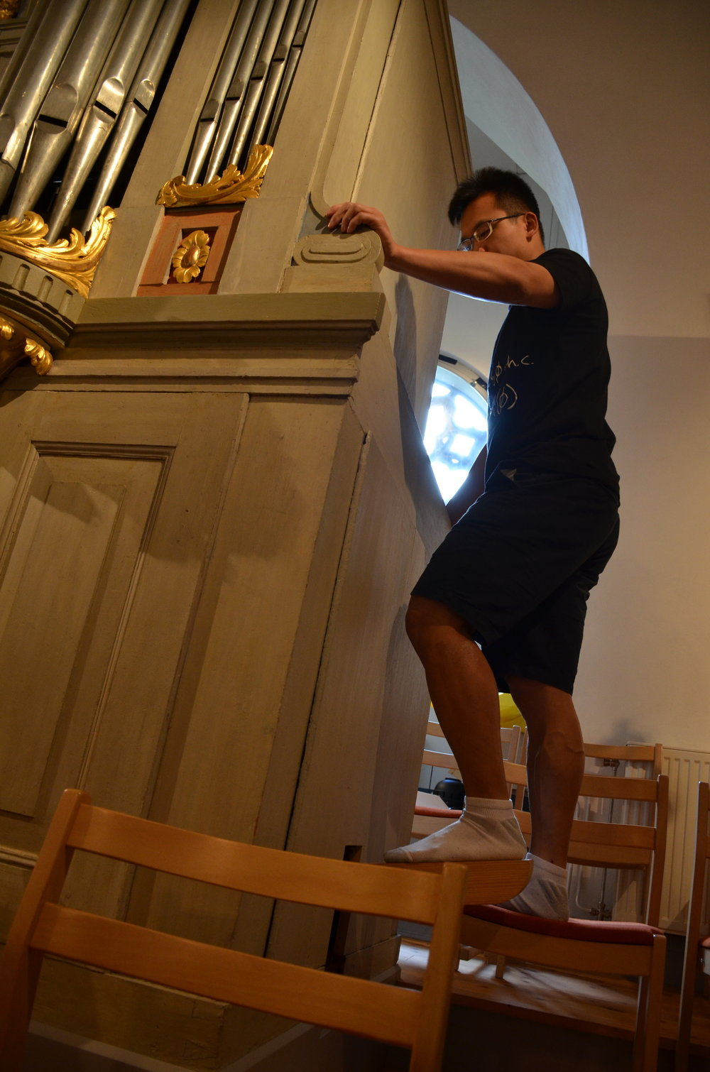 Adrian Cho pumps the bellows, 1783 Schiörlin organ in Jonsered, Sweden.