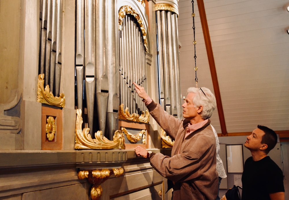Hans Davidsson points out features of the 1783 instrument in Jonsered, Sweden.