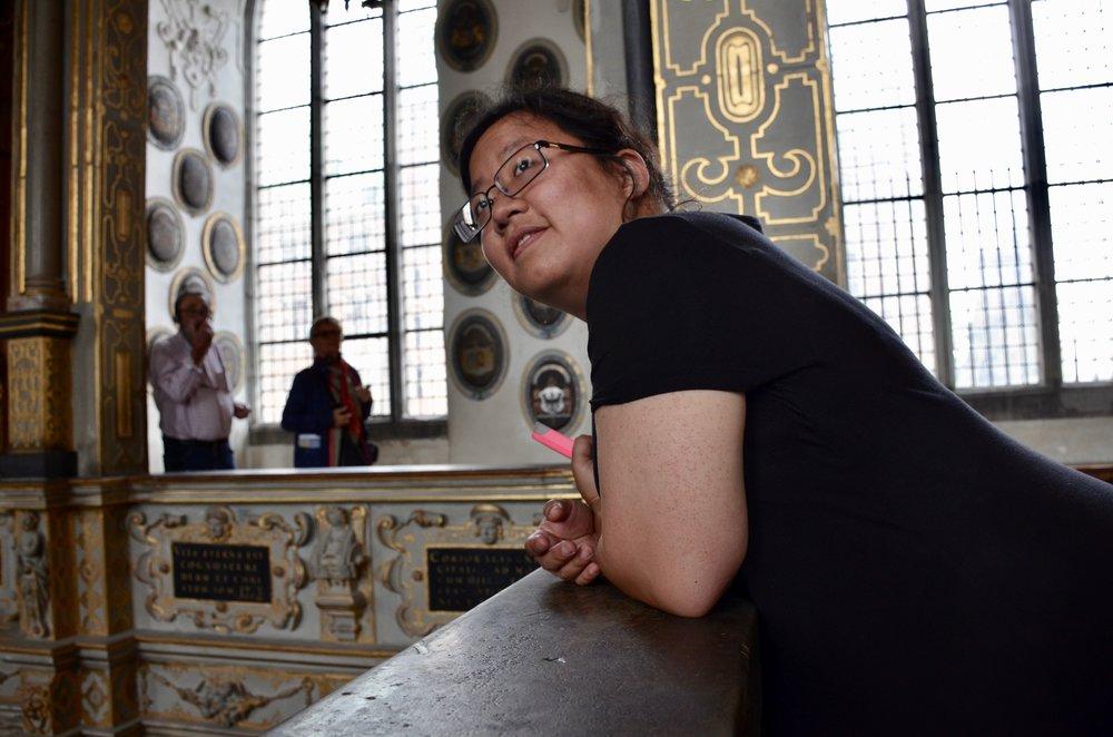 Jennifer Hsiao listens to the 1610 Compenius organ, Frederiksborg Castle, Hillerød, Denmark.