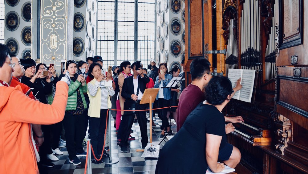 Adrian Cho is a YouTube star, as a sea of tourists record his performance of Sweelinck. 1610 Compenius organ, Frederiksborg Castle, Hillerød, Denmark.