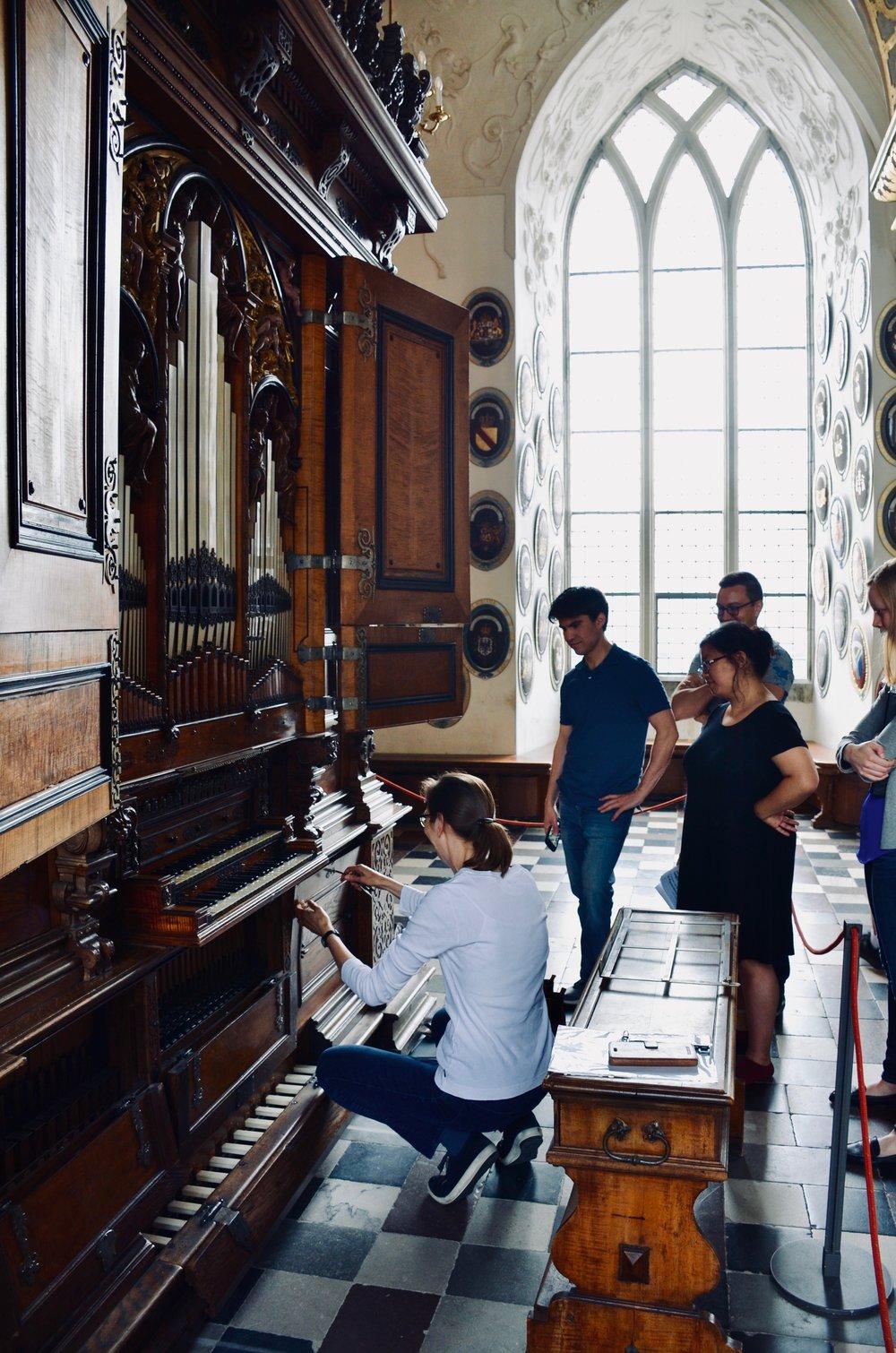 Castle organist Bine Bryndorf locks compartments of the 1610 Compenius organ, Frederiksborg Castle, Hillerød, Denmark.