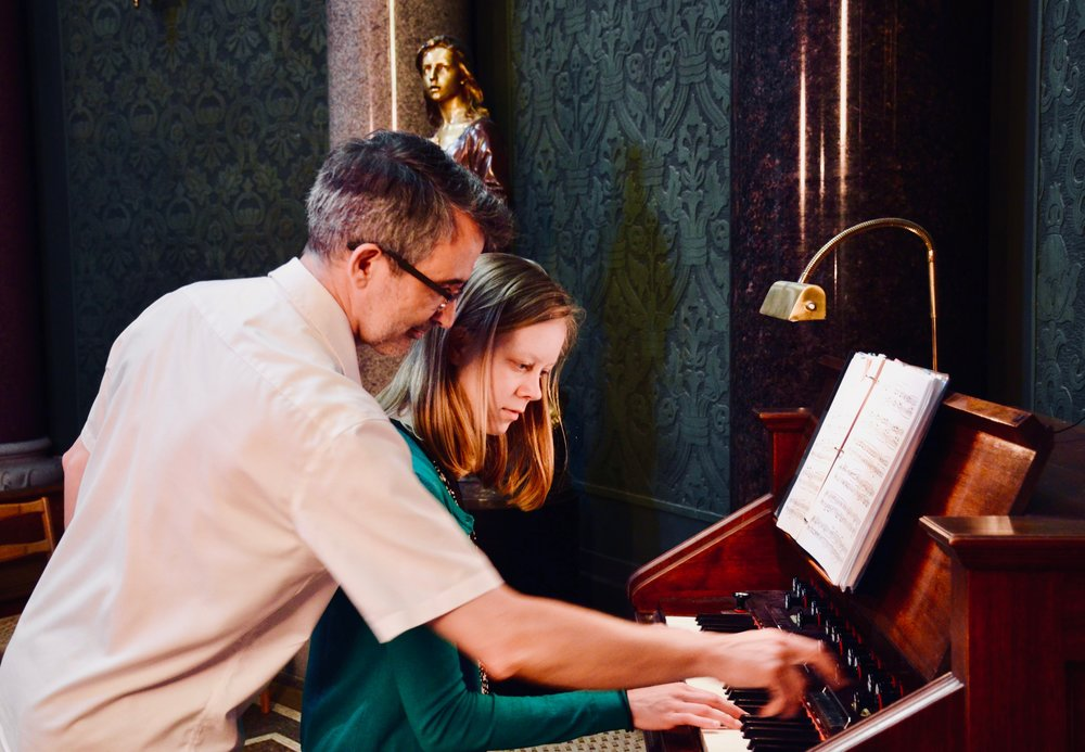 Sven Verner Olsen assists Laura Gullett at the harmonium, Jesuskirke, Copenhagen.