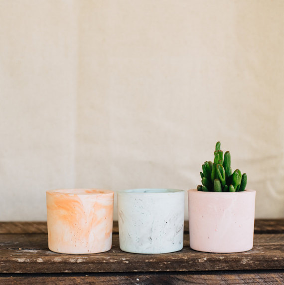 4. Mixed trio of cement planter vessels - $22.93 Adorable and manageable way to step into the plant world, and if the plants die? Tea light holders!