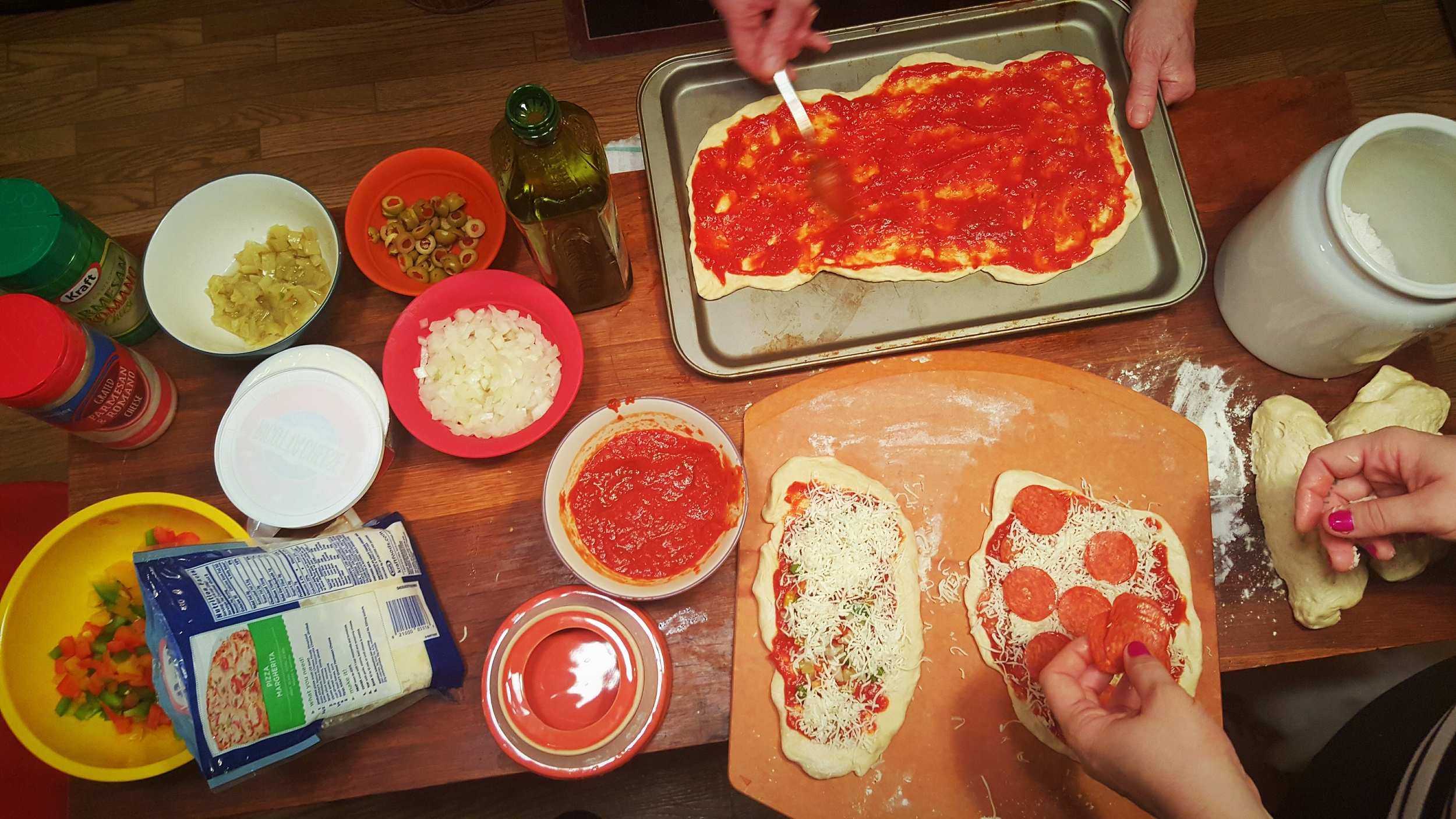 Pizza night- making pizza