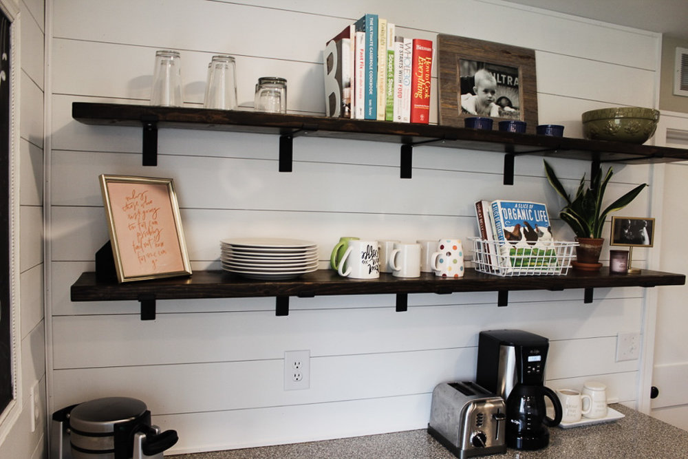 I love how these slightly industrial style farmhouse shelves turned out!  I used a lot of brackets underneath to make sure they would be strong and able to support my beloved cookbook collection, plus some dishes and other decorative items that I'd be able to switch out with the seasons.  It was super easy to make these and they have so much more character than any I could find pre-made.  Sometimes it pays to DIY a little bit!