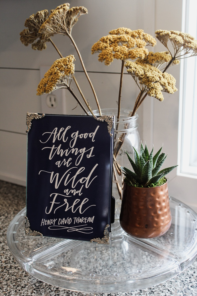 I love to create little vignettes like this one.  They add a touch of whimsy to the spaces I design, and are a great way to add in personal touches like a favorite quote.  Plus, they corral little items and make the display of them look intentional.