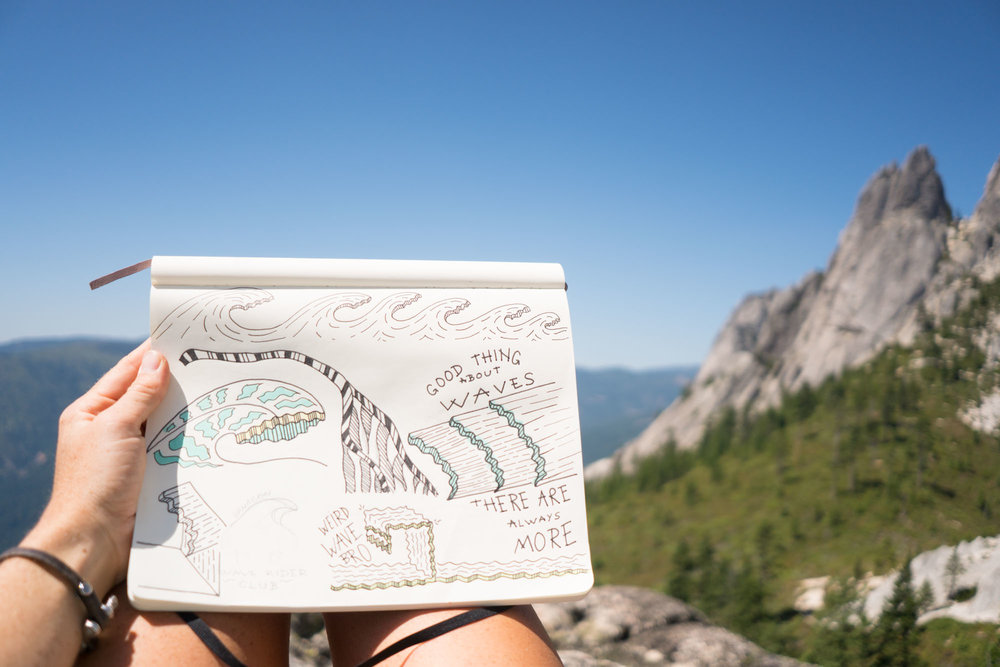 Mak getting some sketching done at the top of Castle Crags