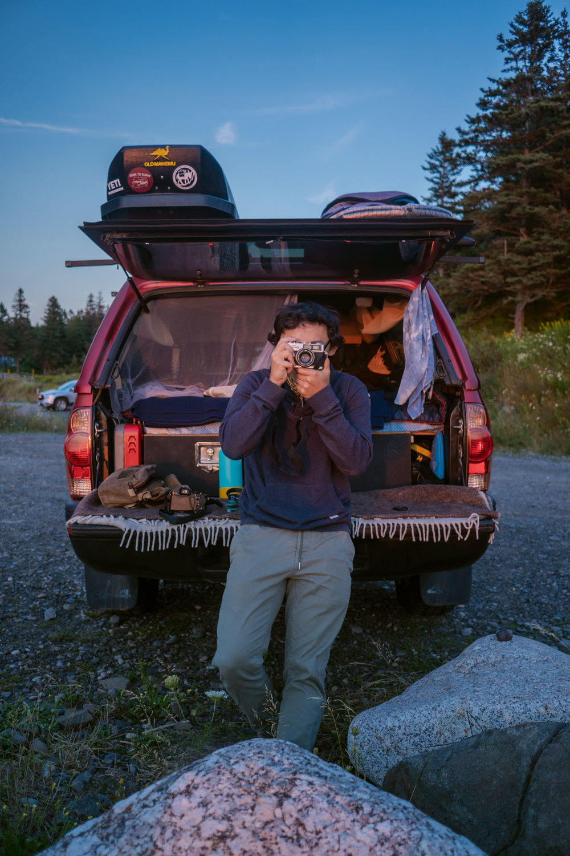 Owen taking a film photo of MAK taking a photo of him