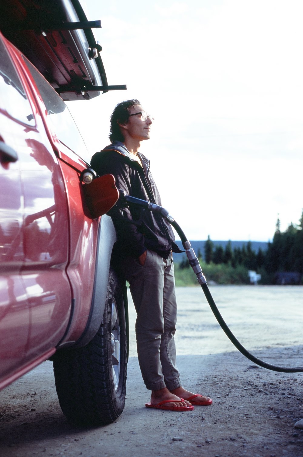 Owen filling up on gas in Churchill Falls where we paid over $7USD a gallon, 35mm