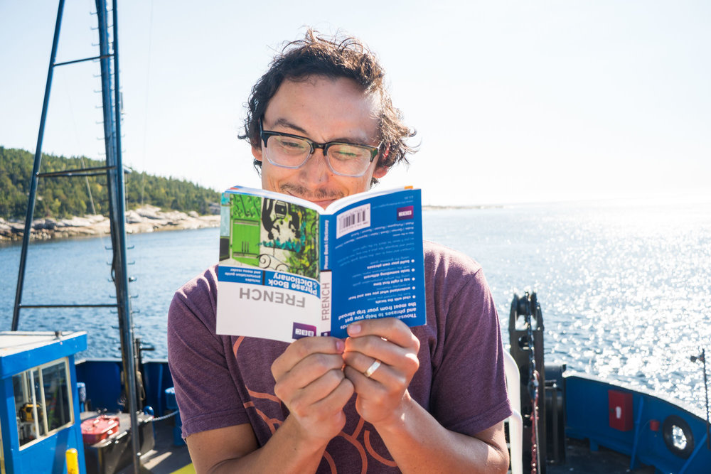 Owen practicing his French while on the ferry crossing of the Saguenay river in Tadoussac, Quebec