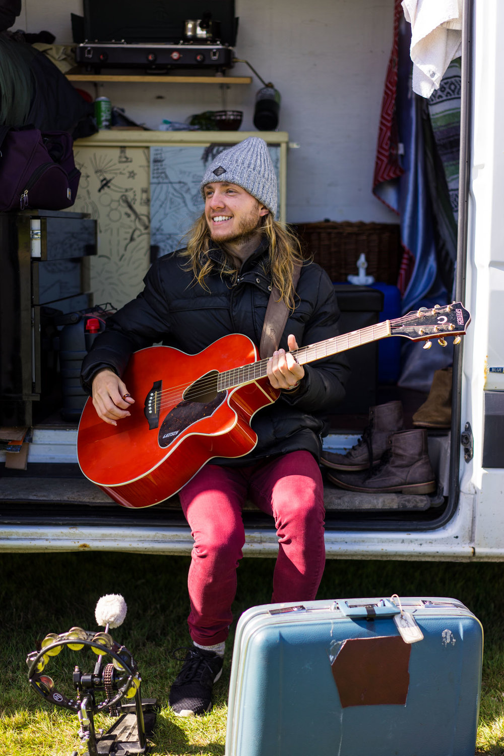 Anthony playing his guitar at camp