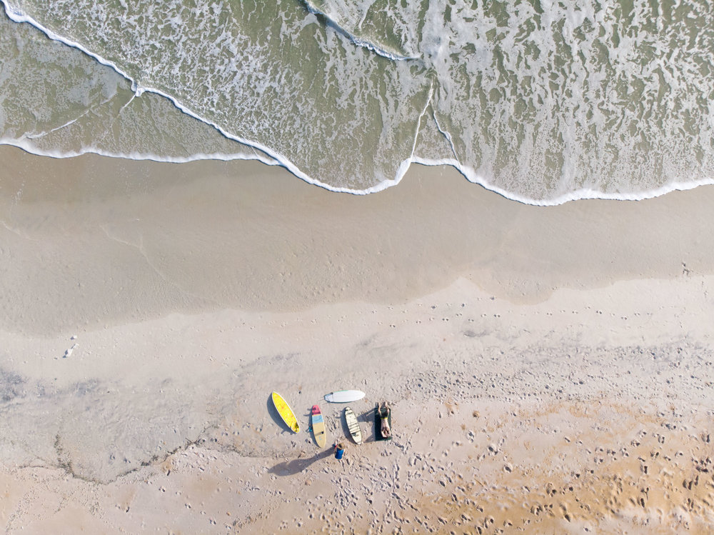 Drone photo of MAK & her cousin Noah after surfing in Ormond Beach