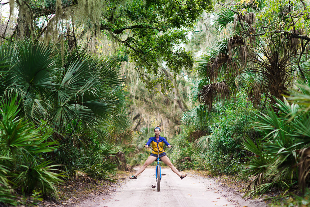 MAK riding her bike into the Cumberland Island wilderness