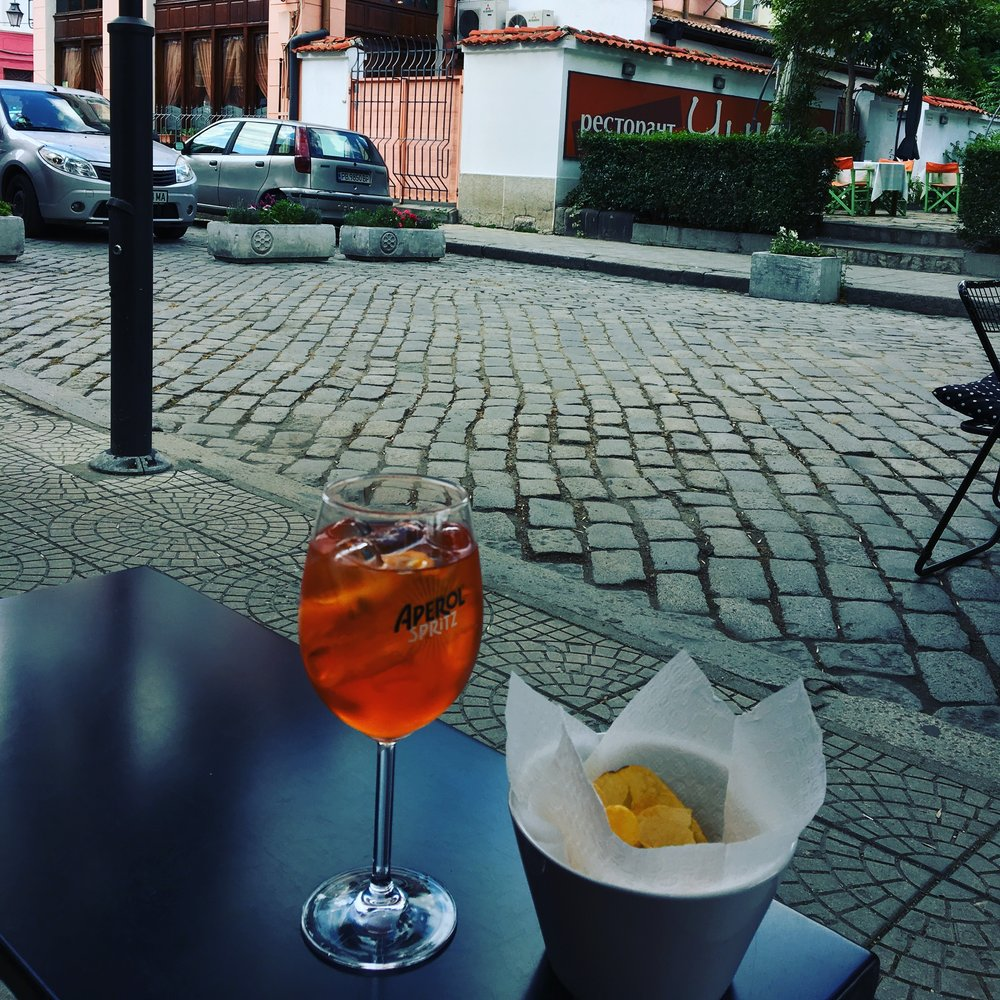 The Artnews Cafe serves a killer aperol spritz and offers a great view of Otets Paisiy St - a landmark Plovdiv street featured in one of the Alternative Plovdiv walks