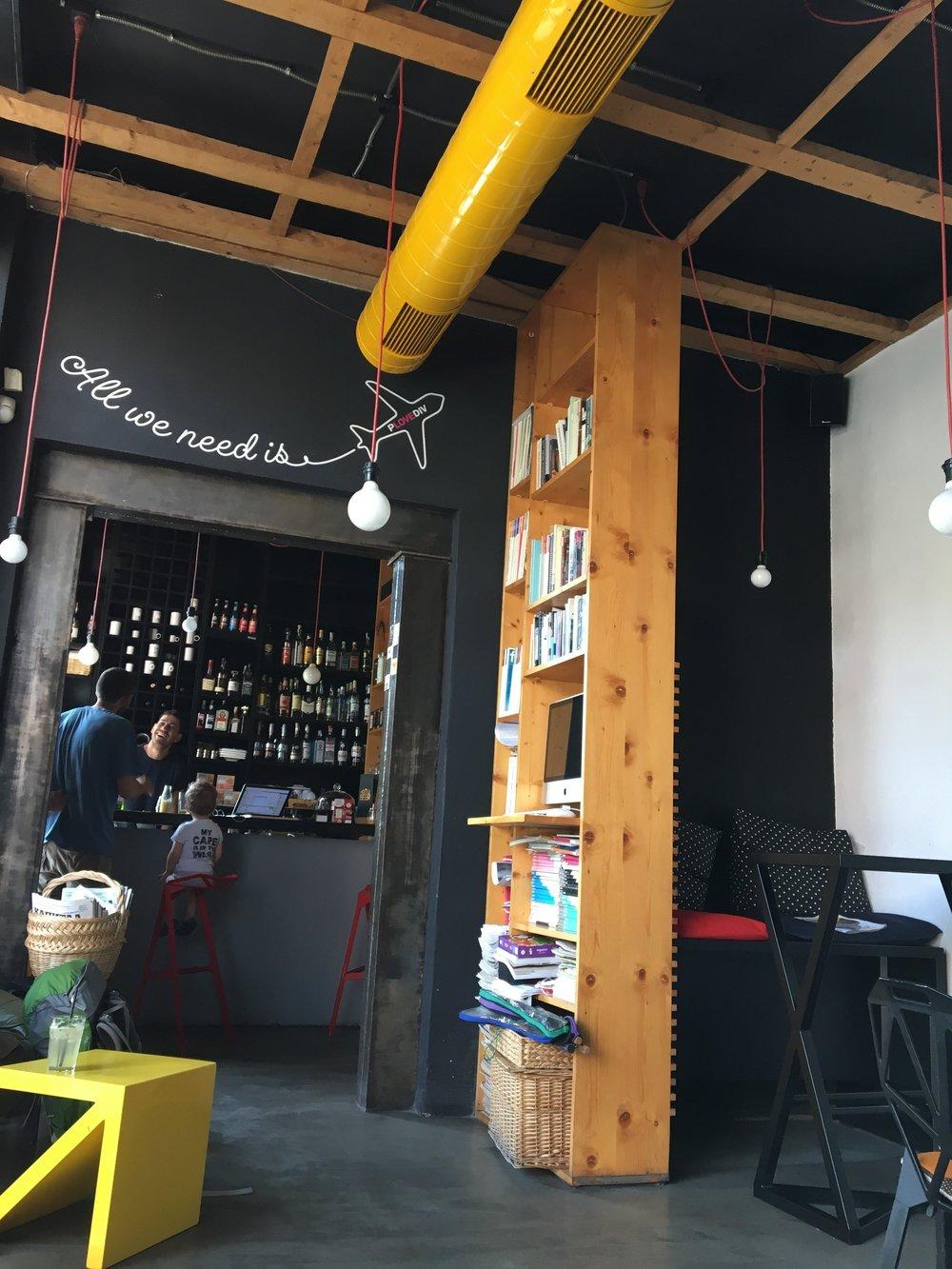 Theartnewscafé doubles as a library/bookstore