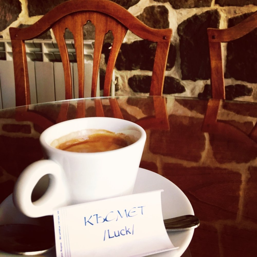 A cup of coffee in Bulgaria almost always comes with a little fortune scroll