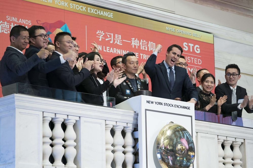 Opening bell ringing during Sunlands IPO at the NYSE