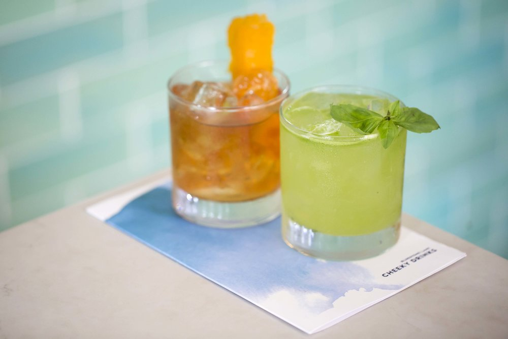 Cocktail against blue tile