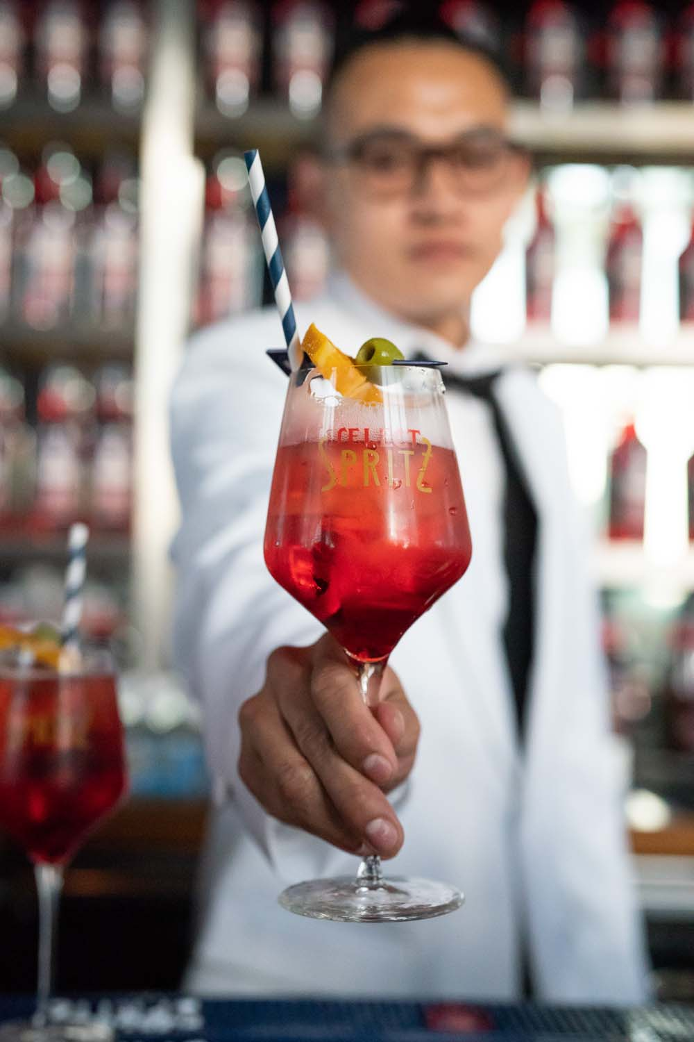 Mixologist in Tuxedo with cocktail