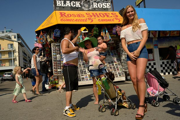 The boardwalk at Venice beach: home to tourists, street performers and Schwarzenegger's old body-building haunt. Photograph: Stephen McLaren