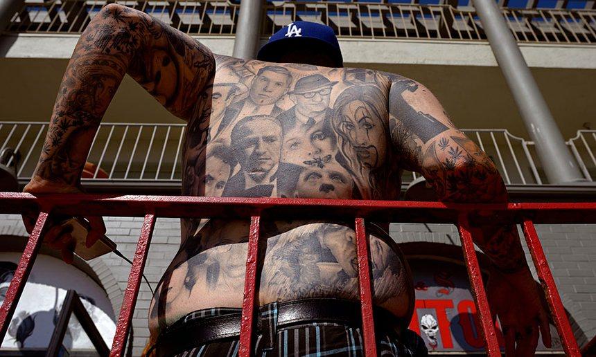 A tattood man on the boardwalk in Venice, California. Photograph: Stephen McLaren