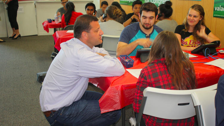 Rep. David Valadao (R-Hanford) speaks with high school interns at his Hanford campaign office. (Sarah D. Wire / Los Angeles Times)