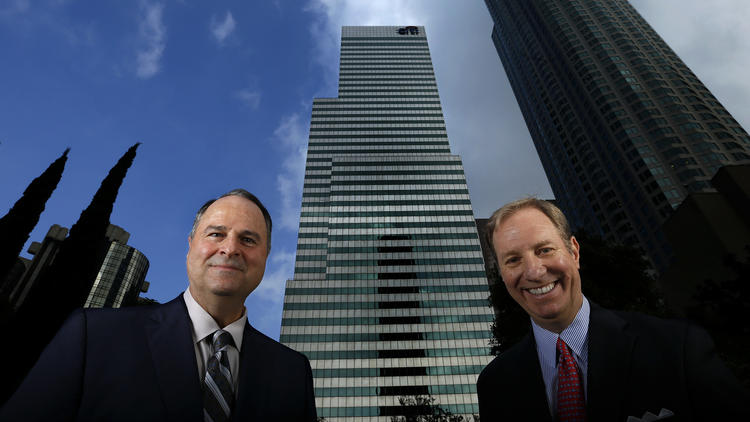Thomas Ricci, left, and John Sischo, managing principals at Coretrust Capital Partners, are the new owners of the Citigroup Center, shown in the center background. They plan a $50-million renovation of the 1980s-era building. (Mel Melcon / Los Angeles Times)