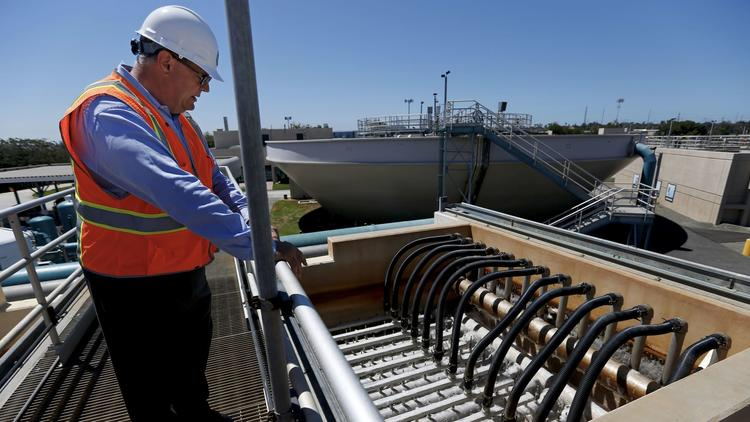 General Manager Rich Nagel explains how the microfiltration process works at the West Basin Municipal Water District water recycling facility in El Segundo. (Gary Coronado / Los Angeles Times)