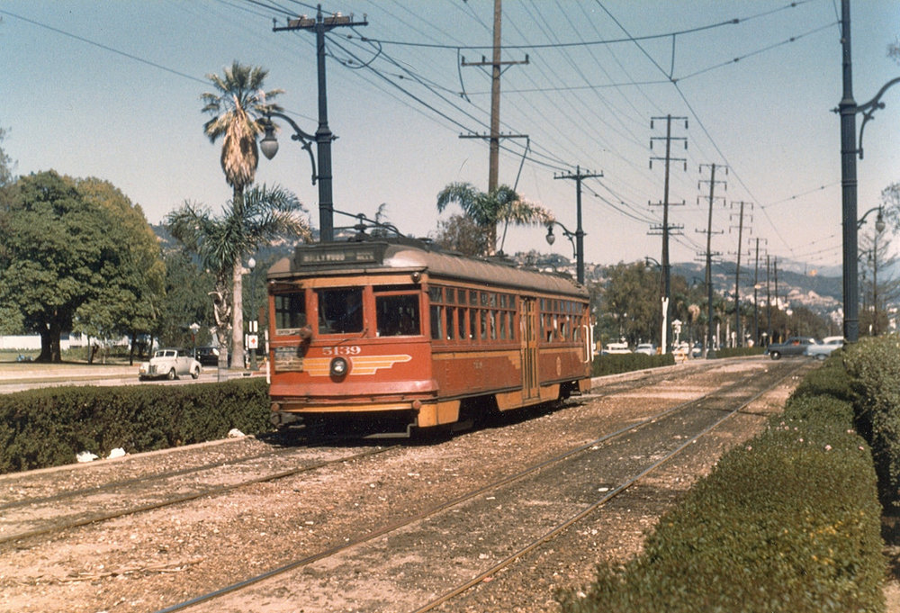 A Pacific Electric car on Santa Monica Boulevard at Canon in Beverly Hills, 1954. Photo by Alan K. Weeks, courtesy of the Metro Transportation Library and Archive.