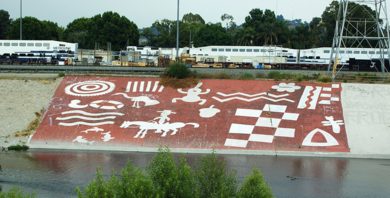 Frank Romero's mural on the concrete banks of the LA River north of Downtown depicts abstract images of Anza, a Spanish captain and indigenous symbols.