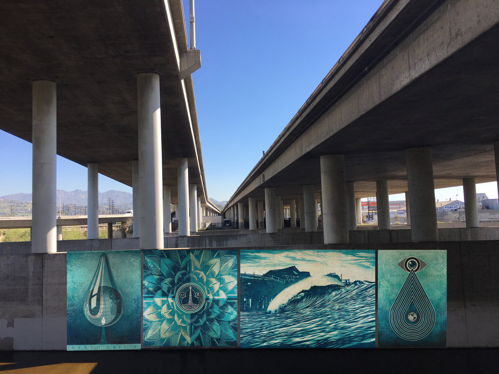 Proposal for reduced impact project near 134 Freeway intersecting with LA River near Griffith Park with examples of water themed images like these from Shepard Fairey's 2016 Earth Crises series for the Paris Climate Conference.