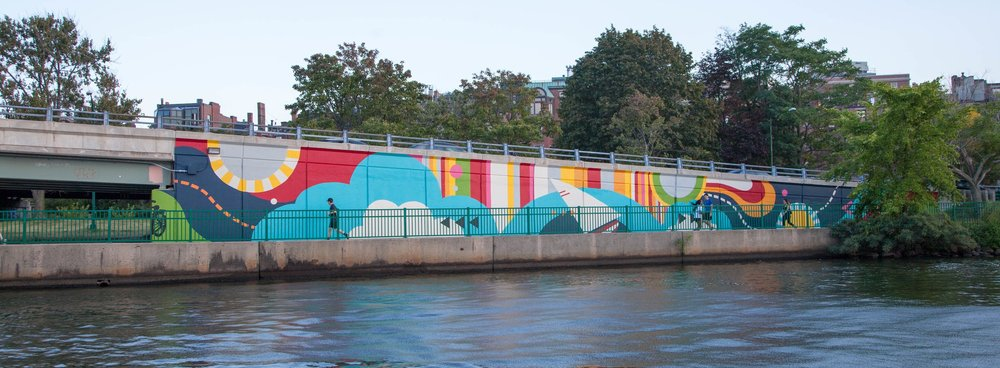 Patterned Behaviorby Silvia López Chavezhas transformed and enlivened an unwelcoming concrete underpass along the The Charles River Esplanade by creating a striking, joyful mural that echoes the beauty, diversity, and energy of Boston.