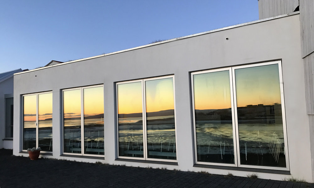 Sun reflecting off the windows at the Textile Museum at sunset - Blönduós, Iceland.