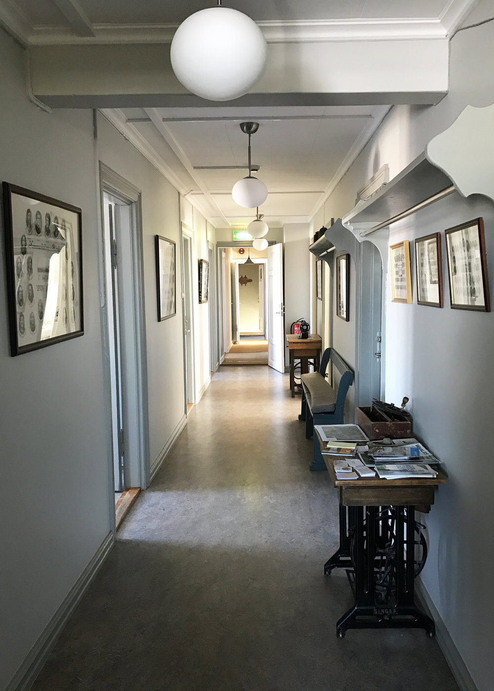 The hallway of our residency. Lined with the class images of past college attendees. Blönduós, Iceland.