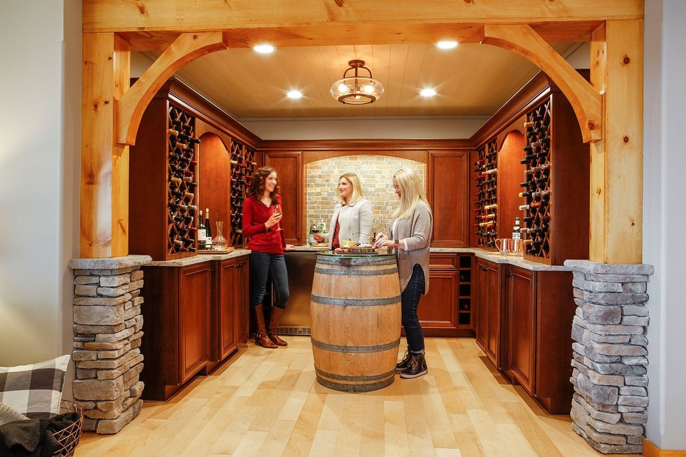 Entertaining bar with built-in wine storage, sink, and beverage fridge.