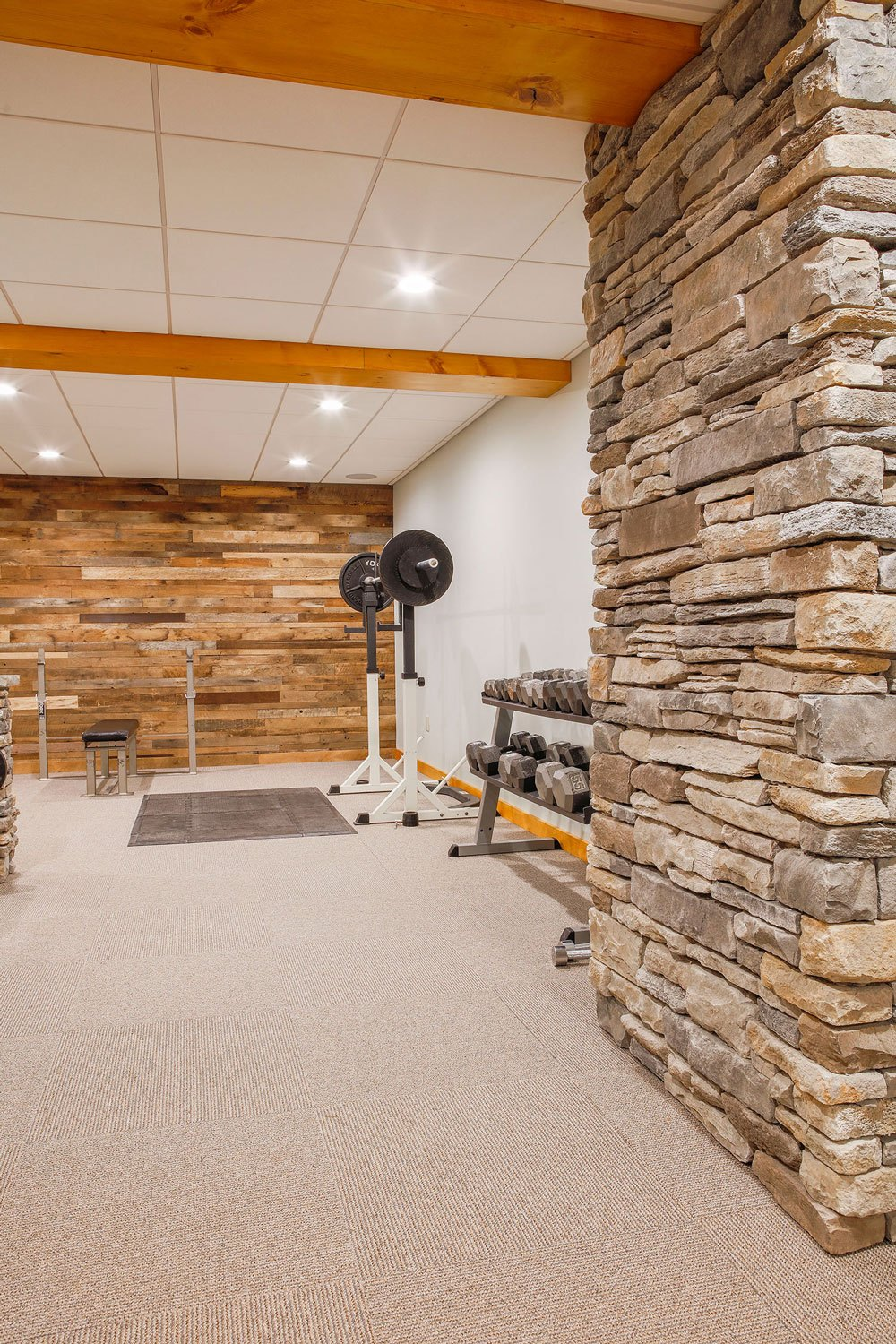 Stone wall and reclaimed wood wall.