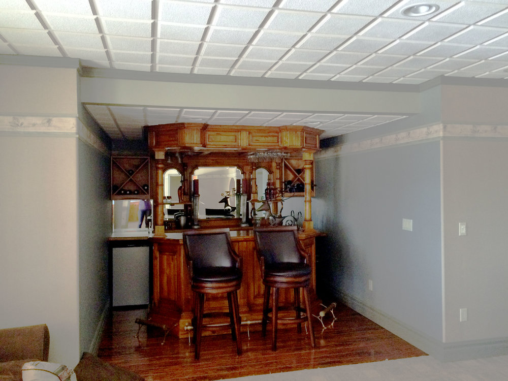 Bar area before - dark and dated with empty space on the sides