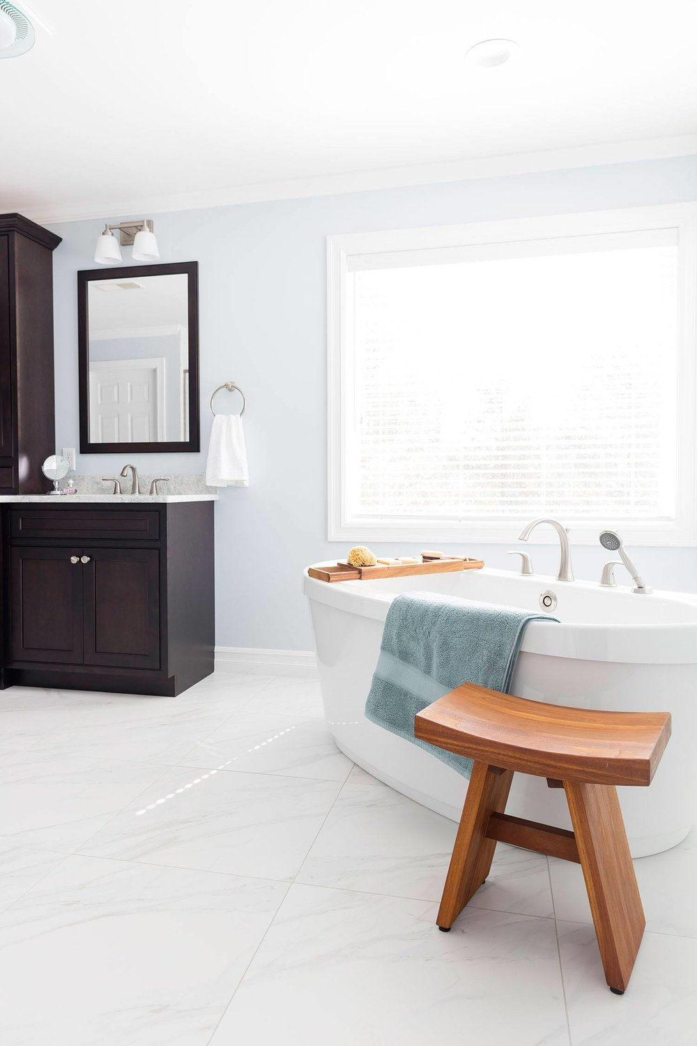 bath-retreat-master-freestanding-tub-white-tile-floor.jpg