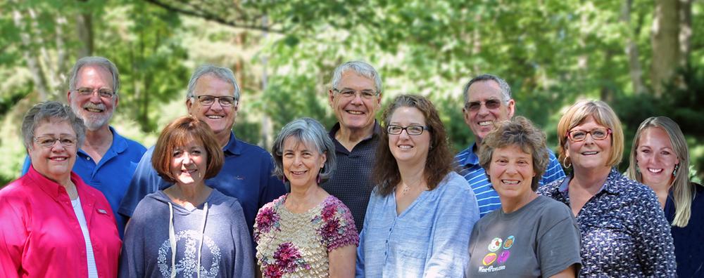 Front row: Nancy Silvey, Karen Viele, Ellie Schroeder, Sheryl Hnizda, Lisa Corso, Sue Waechter. Back row: Larry Schroeder, Dave Viele, Roger Moll, Dave Molzahn, Nena Kuhr