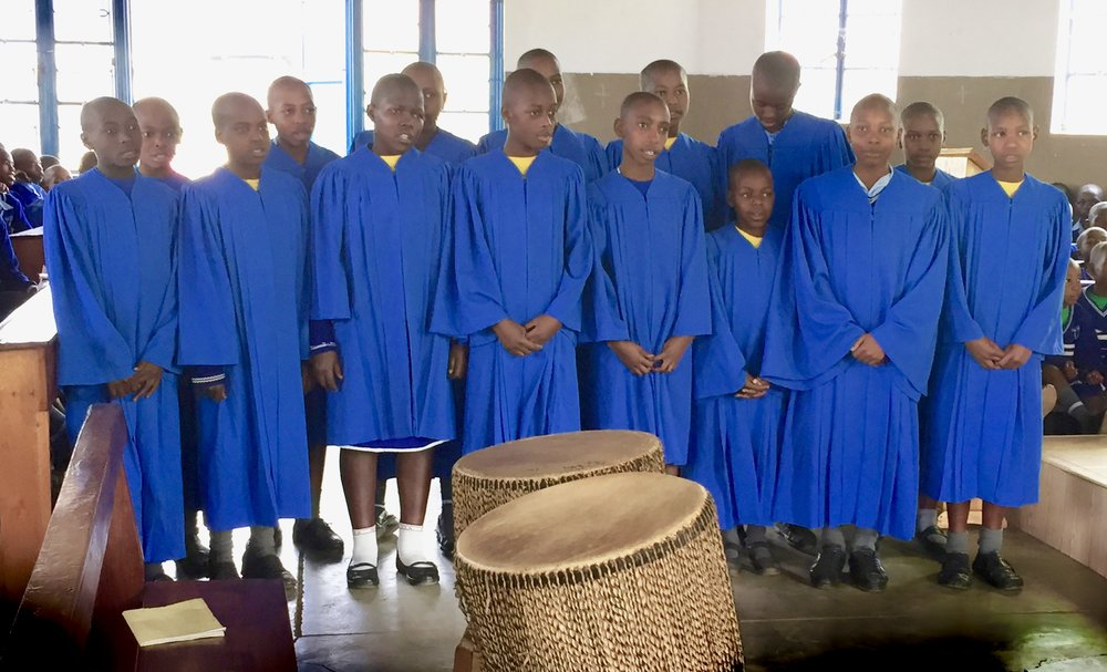 Youth choir at Uganda Martyrs were very happy with their fancy robes