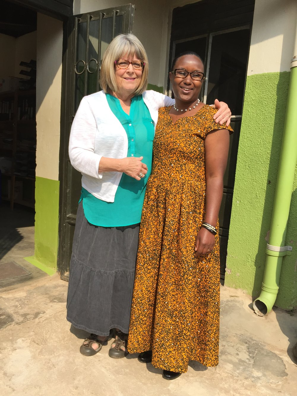 Sue and Generous ready for church outside the ACT Empowerment Center