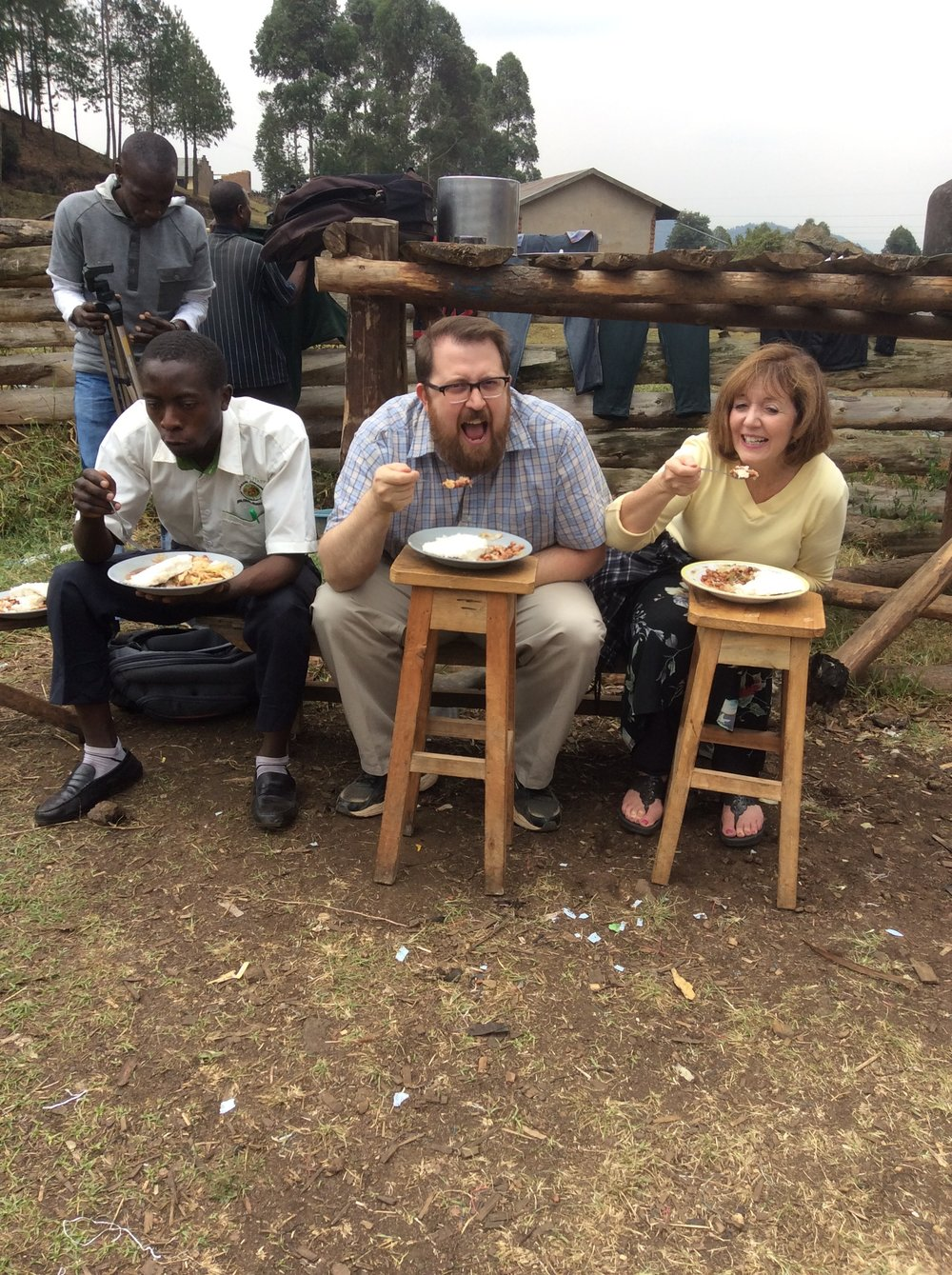 Howard, Joe and Karen eating posho at Muko High School