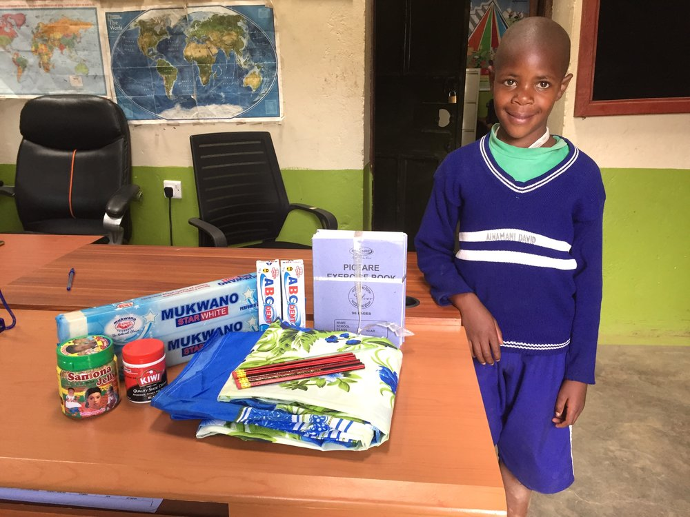 David is another orphan who has already been in our program so this photo shows what his sponsorship provides for his school year. Laundry soap, body lotion, black shoe polish, sheets, pencils, toothpaste, composition books.