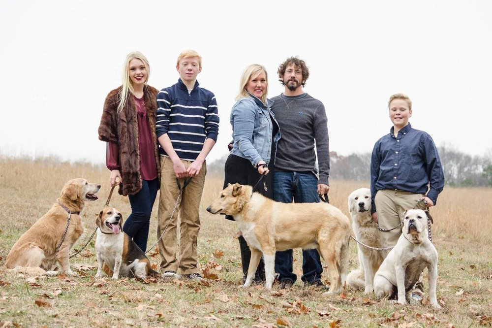 Owners Polly and Jay Burrows with their three children and four-legged family members.