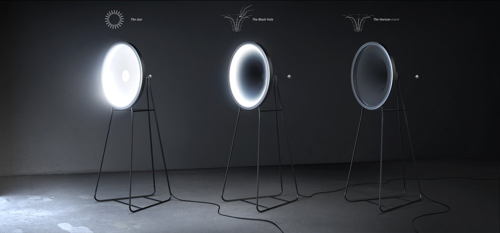 - A popular depiction of a black hole is an unseen force of nature drawing light down to a single point in space. Using this analogy, the 'Black Hole Lamp' controls the intensity of the light being emitted by creating a funnel from which the light cannot escape. In the 'on' position the reflective disc of material is fully illuminated, but as the flexible disc is drawn back towards the center of the black hole, the light gets dimmer until it eventually disappears