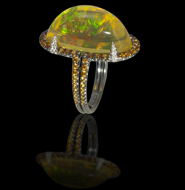 Gothic Opal You have a little world dancing inside the opal on your finger, you are the queen of your kingdom and the ruler of all things beautiful and rare.                        Ring in 18 karat White Gold, White Diamond, Spessartite Garnet and Mexican Opal. Sorry this just sold