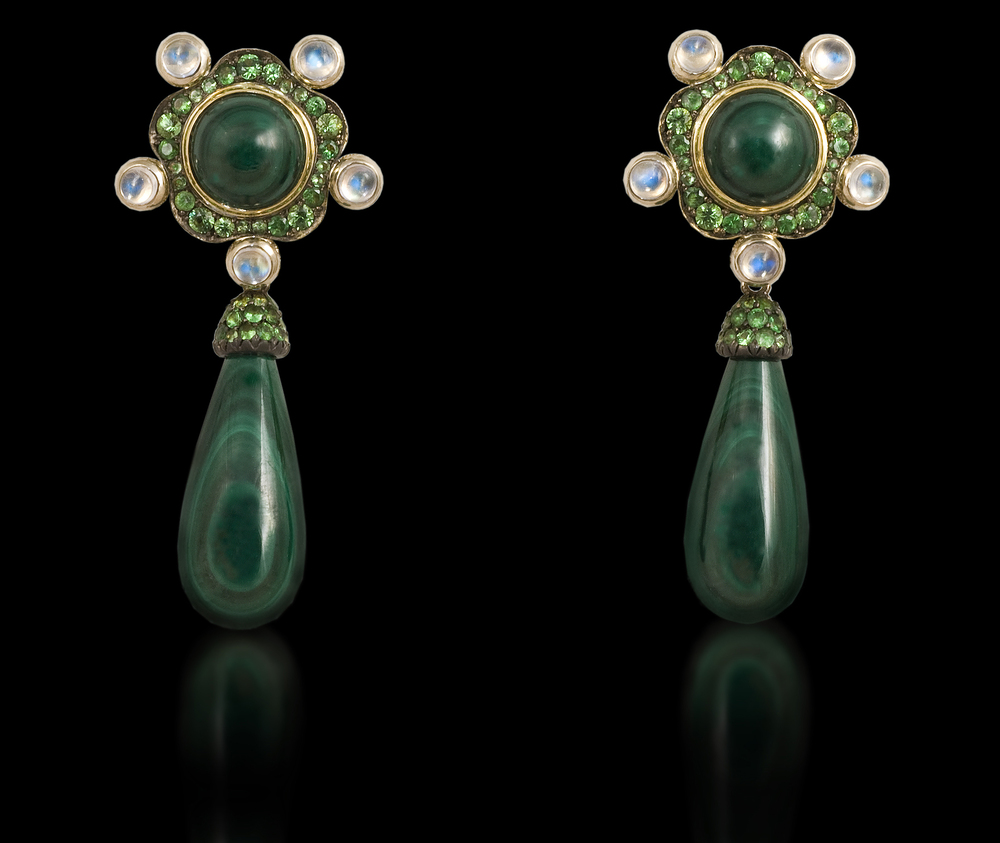 Ethiopian Queen   In the darkness of the green forest jewels of water and gems sparkle in the night.    Earrings in 18 karat White Gold, with Malachite, Moonstone, and Green Garnet      $8,500