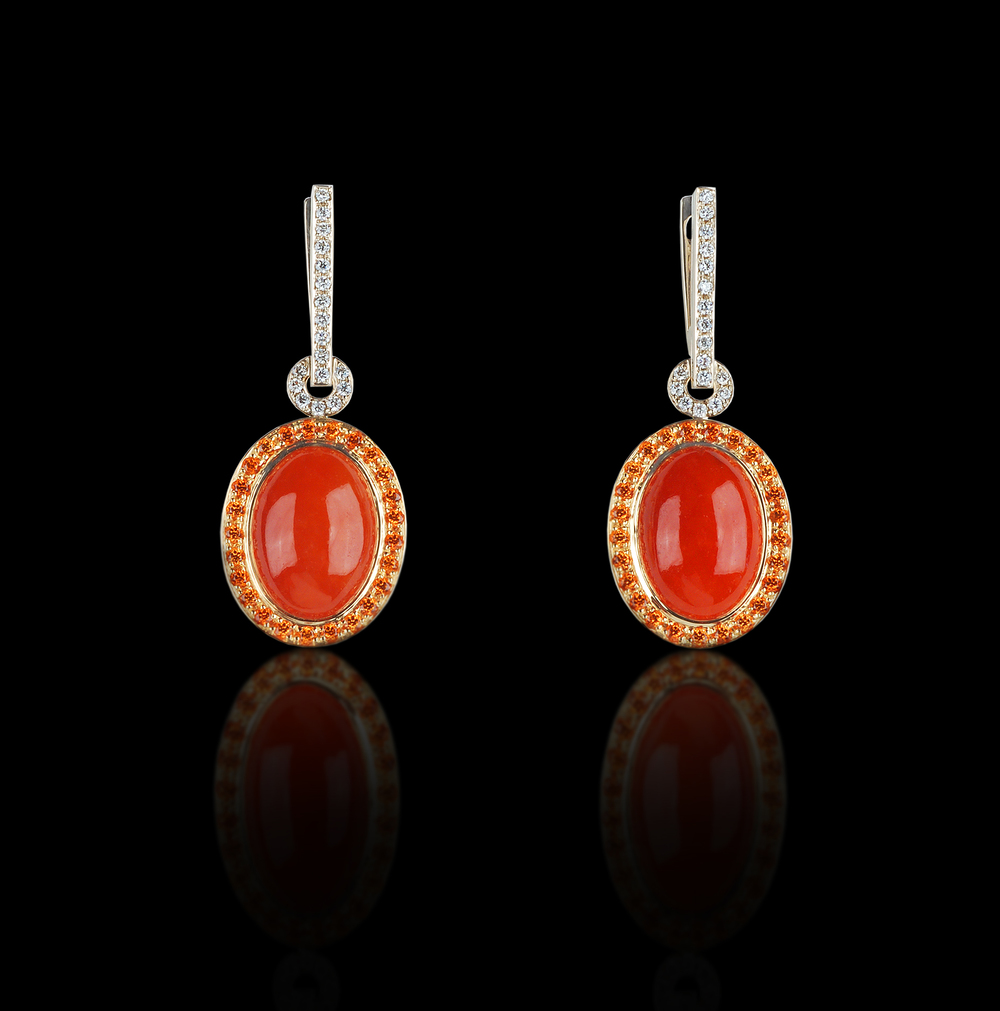 Red Splendor Passion is best harnessed and displayed for all to enjoy. Earrings in 18 karat Yellow and White Gold, with Spessartite garnets, Red Jade, and White Diamonds $9,000